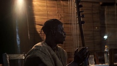 Musician sings and plays the kora, traditional African musical instrument. Stock Footage