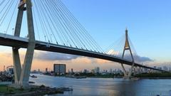 Clouds spread across the sky before sunset at Bhumibol Bridge under twilight Stock Footage