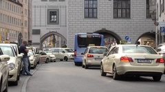 4K Bustling traffic street in Munich town taxi car jam in downtown city travel Arkistovideo
