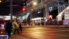 People directing traffic for commuters crossing street to take bus or skytrain Stock Footage
