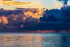Sea sunset quietly Stock Photos