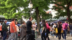 4K Group tourist people visit old street market in Munich local restaurant place Stock Footage