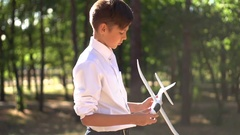 Teenager attentively considers a model airplane. Stock Footage