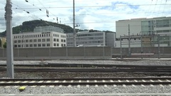 4K POV Point of view train transit urban town of Salzbourg arrival railway way Stock Footage