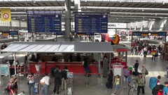 4K Aerial view Munich central train station platform time table and local shop Stock Footage