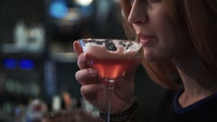 Beautiful woman drinking cocktail Stock Footage