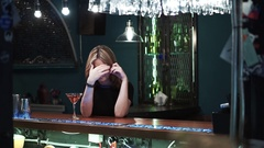 Tired drunk beautiful woman with cocktail in hand Stock Footage