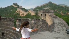 Happy cheerful joyful tourist woman at Great Wall of China having fun travel Stock Footage