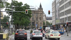 4K Traffic street in downtown Munich car wait at stop light people cross road  Stock Footage