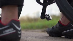 A foot on pedal of bicycle Stock Footage