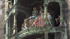 4K Closeup Glockenspiel moving statue show at Munich tourism attraction emblem Stock Footage