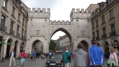 4K Tourist people visit shopping street in Munich old town ancient gate entrance Stock Footage