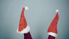 Young man showing a puppet show using a Santa hat Christmas preparation Stock Footage