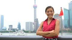 Business woman portrait in Shanghai China showing Pudong financial district Stock Footage