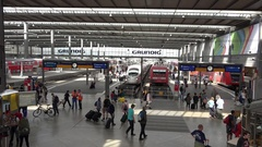 4K Panorama busy Munich indoor central train station people travel commute icon Stock Footage