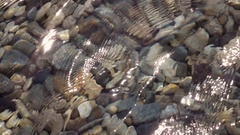 Flecks of sunlight on the ripple water surface. Shoot in extreme slow motion. Stock Footage