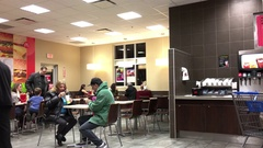 Motion of people eating food at mcdonalds restaurant Stock Footage