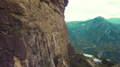 Mountain aerial flyover. Span next to the rock wall. Stock Footage