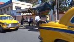 Indian traffic, pedestrians sidewalk Kolkata Stock Footage