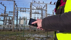 Electrician engineer using tablet near substation close up Stock Footage