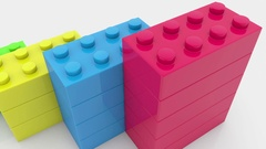 Toy bricks in various colors on white Stock Footage