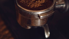 Close up of coffee grounds in vessel of coffee maker Stock Footage