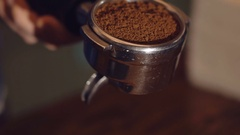 Process of pressing coffee grounds in vessel Stock Footage