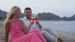 Happy Couple Toasting Glasses Drinking Wine on Romantic Date on Beach Stock Footage