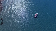 Motor boat cruising along the ocean or sea coast in circles on a sunny day. Stock Footage