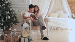 Happy family near Christmas tree in house interior Arkistovideo