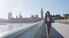 Young urban professional woman walking in London with purse after shopping Stock Footage