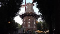 4k Bremen city famous windmill restaurant hidden in park area Stock Footage