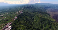 Aerial of Batur volcano. Flying along road on high altitude over the canyon Stock Footage