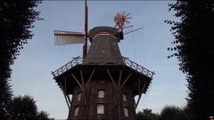 4k Bremen city famous windmill restaurant tilt down in park area Stock Footage