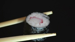 Tasty Pieces of sushi on a black stone Stock Footage