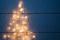 Christmas card with luminous festoon Stock Photos