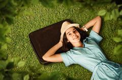 Young woman dreams of a future journey. Stock Photos