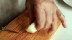 Grandma sliced egg. Preparation of a dish herring under a fur coat. Stock Footage