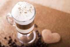 Irish cream coffee decorated with coffee beans on the table Stock Photos