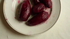 Purified beets, eggs and onions lie on the plates on the table Stock Footage