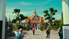 Thailand Bangkok Entrance to the temple guarded by two majestic Stock Footage