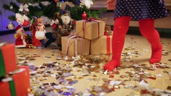 Little girl takes a candy from Christmas gifts Stock Footage