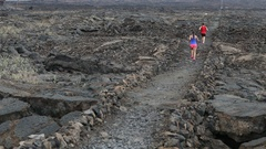 Cross country running woman and man trail runners exercising outside Stock Footage
