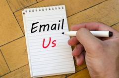 Email us concept on notebook Stock Photos