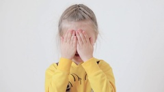 Little girl covering her eyes with her hands Stock Footage