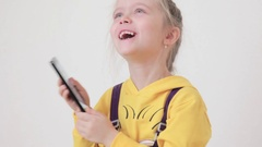 Child Playing on a Touchscreen Phone, Smartphone, Children Stock Footage