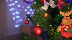 Decorated Christmas tree on blurred, sparkling and fairy background Stock Footage