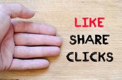 Like share clicks text concept Stock Photos