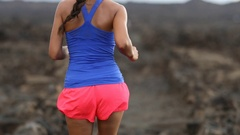 Sport and fitness runner woman running cross-country trail run training outside Stock Footage