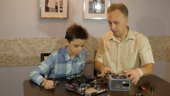 Dad teaches his son a teenager, what's inside the computer. Power Supply Stock Footage